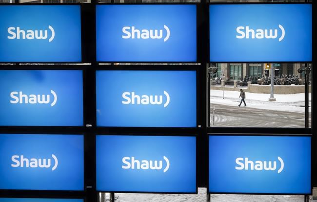 Shaw logos are on display at the company's annual meeting in Calgary, Jan. 17, 2019. THE CANADIAN PRESS/Jeff McIntosh