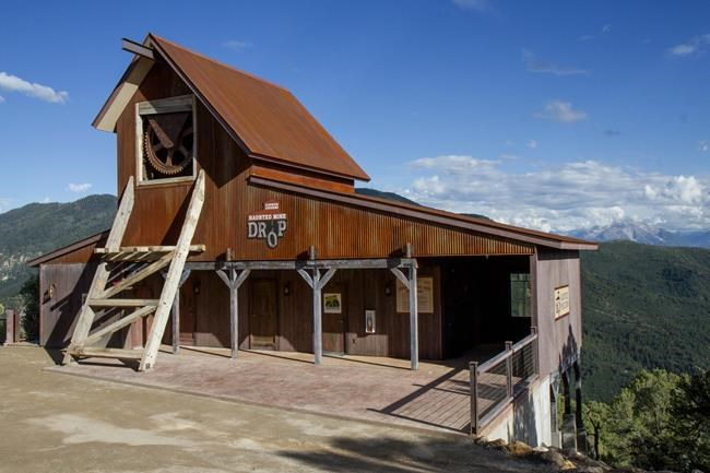 FILE - The Haunted Mine Drop is shown in this July 2017 file photo at Glenwood Caverns Adventure Park in Glenwood Springs, Colo. The parents of a 6-year-old Colorado girl who fell 110 feet to her death on the theme park ride after not being buckled in are suing the park. The lawsuit filed Wednesday, Oct. 20, 2021, alleges Glenwood Caverns Adventure Park recklessly caused her death by failing to train the ride's operators despite previous problems with its seat belts. (Chelsea Self/Glenwood Springs Post Independent via AP, File)