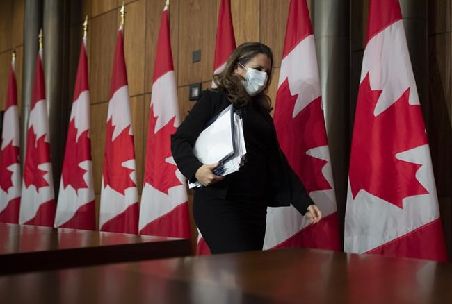 Deputy Prime Minister and Minister of Finance Chrystia Freeland leaves a news conference held before presenting the Fiscal update in the House of Commons in Ottawa, Monday November 30, 2020. THE CANADIAN PRESS/Adrian Wyld