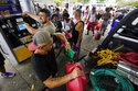 In the aftermath of Hurricane Ida, people wait in line for gas Tuesday, Aug. 31, 2021, in New Orleans, La. (AP Photo/Eric Gay)