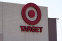 A sign at a Target store is pictured Thursday, June 24, 2021, in Oklahoma City.  Target Corp. is joining a growing list of retailers and restaurant chains offering educational assistance at select online institutions for its front-line workers amid a fiercely competitive labor market. The Minneapolis-based discounter said Wednesday, Aug. 4,  that it plans to spend $200 million over the next four years to offer its workers free undergraduate and associate degree programs in business-oriented majors at select institutions such as University of Arizona and University of Denver.  (AP Photo/Sue Ogrocki)