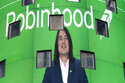FILE - Vladimir Tenev, CEO and co-founder of Robinhood, is shown on an electronic screen at Nasdaq in New York's Times Square following his company's IPO, Thursday, July 29, 2021. Robinhood's stock is flying again Wednesday, Aug. 4, jumping so much that trading was temporarily halted three times in the first half hour after the market opened. (AP Photo/Mark Lennihan, File)