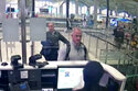 FILE— This Dec. 30, 2019 image from security camera video shows Michael L. Taylor, center, and George-Antoine Zayek at passport control at Istanbul Airport in Turkey. Americans Michael Taylor and his son Peter Taylor go on trial in Tokyo on Monday, June 14, 2021, on suspicion they helped Nissan former Chairman Carlos Ghosn skip bail in Japan and escape to Lebanon in December 2019. (DHA via AP, File)