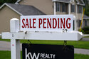 """FILE - A """"sale pending"""" sign is posted outside a single family home in a residential neighborhood, Wednesday, July 14, 2021, in Derry, N.H. Mortgage rates were mixed last week. The key 30-year home loan remained below 3% for the fifth straight week amid continued concern over the surging delta coronavirus variant and the progress of economic recovery. Mortgage buyer Freddie Mac reports that the average for the 30-year mortgage edged up to 2.80% from 2.78% last week.  (AP Photo/Charles Krupa, File)"""