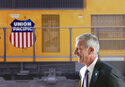 FILE- In this Feb. 17, 2017, file photo, Union Pacific Chairman, President and CEO Lance Fritz, smiles after a news conference at the Durham Museum in Omaha, Neb. During his time as Union Pacific's CEO,  Fritz has had to find ways to keep the freight moving during the coronavirus pandemic as the economy nearly ground to a halt and then roared back to life. Now he is working to help clear up a major backlog in imported shipments.   (AP Photo/Nati Harnik, File)