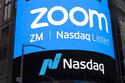 """FILE - This April 18, 2019, file photo shows a sign for Zoom Video Communications ahead of their Nasdaq IPO in New York. A U.S. government committee that reviews foreign investment in telecom is probing videoconferencing company Zoom's $14.7 billion deal for cloud call center company Five9 for national security risks due to """"foreign participation."""" The Justice Department declined to answer questions Tuesday, Sept. 21, 2021. (AP Photo/Mark Lennihan, File)"""