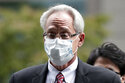 FILE - In this Sept. 15, 2020, file photo, former Nissan Motor Co. executive Greg Kelly arrives for the first trial hearing at the Tokyo District Court in Tokyo. Former Nissan chairman Carlos Ghosn has backed his former colleague American lawyer Kelly's insistence on his innocence of any wrongdoing. (Kiyoshi Ota/Pool Photo via AP, File)
