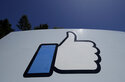 """FILE - This April 25, 2019, file photo shows the thumbs-up """"Like"""" logo on a sign at Facebook headquarters in Menlo Park, Calif. Facebook's semi-independent oversight board says the company has failed to fully disclose information on its internal system that exempts high-profile users from some or all of its content rules. Facebook """"has not been fully forthcoming"""" with the overseers about its """"XCheck,"""" or cross-check, system the board said in a report Thursday, Oct. 21, 2021. (AP Photo/Jeff Chiu, File)"""