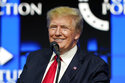 FILE - In this July 24, 2021, file photo former President Donald Trump smiles as he pauses while speaking to supporters at a Turning Point Action gathering in Phoenix. Digital World Acquisition Corp., the company planning to bring President Donald Trump's new media venture to the stock market, soared further on Friday, Oct. 22, 2021 amid another frenzy of trading.  (AP Photo/Ross D. Franklin, File)