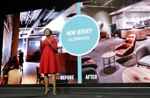 FILE - Starbucks COO Roz Brewer talks about the proposed redesign of a Starbucks store in New Jersey as she speaks Wednesday, March 20, 2019, during the company's annual shareholders meeting in Seattle. Walgreens has tapped Roz Brewer as its new CEO, which will make her the only Black woman currently leading a Fortune 500 company. Brewer will take over as Walgreens CEO on March 15, 2021 after a little more than three years as Starbucks' chief operating officer. (AP Photo/Ted S. Warren, file)