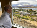 In this Tuesday, Oct. 5, 2021, photo, The Dalles Mayor Richard Mays looks at the view of his town and the Columbia River from his hilltop home in The Dalles, Oregon. Mays helped negotiate a proposal by Google to build new data centers in the town. The data centers require a lot of water to cool their servers, and would use groundwater and surface water, but not any water from the Columbia River. (AP Photo/Andrew Selsky)