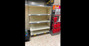 """A view of empty shelves at a Morrisons storem in BelleVale, Liverpool, England, Wednesday July 21, 2021. Retailers in England warned Thursday of barren supermarket shelves as more and more staff get """"pinged"""" on their phones to self-isolate because of contact with coronavirus cases. Grappling with staff shortages amid the so-called """"pingdemic,"""" many businesses, such as supermarket chain Iceland, have had to close some stores. (Peter Byrne/PA via AP)"""