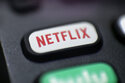 This Aug. 13, 2020, photo shows a logo for Netflix on a remote control in Portland, Ore. Netflix reported its worst slowdown in subscriber growth in eight years as people emerge from their pandemic cocoons. But it has an answer to that: Video games. On Tuesday, July 20, 2021 the streaming giant announced plans to begin adding video games to its existing subscription plans at no extra cost. The confirmation of the long-anticipated expansion came in conjunction with the release of its latest earnings report. (AP Photo/Jenny Kane)
