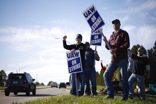 Members of the United Auto Workers strike outside of the John Deere Engine Works plant on Ridgeway Avenue in Waterloo, Iowa, on Friday, Oct. 15, 2021. About 10,000 UAW workers have gone on strike against John Deere since Thursday at plants in Iowa, Illinois and Kansas.(Bryon  Houlgrave/The Des Moines Register via AP)
