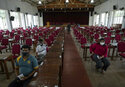 Sri Lankan university students wait to receive their coronavirus vaccine at the Sri Jayawardenapura university in Colombo, Sri Lanka, Monday, Oct. 11, 2021. (AP Photo/Eranga Jayawardena)