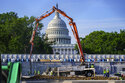 FILE - A concrete pump frames the Capitol Dome during renovations and repairs to Lower Senate Park on Capitol Hill in Washington, Tuesday, May 18, 2021. Plans to pump money into rebuilding the nation's roads, bridges and other infrastructure could give companies that make machinery and materials a solid foundation for growth. (AP Photo/J. Scott Applewhite, file)