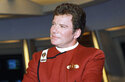 """FILE - In this 1988 file photo, William Shatner, who portrays Capt. James T. Kirk, attends a photo opportunity for the film """"Star Trek V: The Final Frontier."""" The performer who breathed life into Kirk is, at age 90, heading toward the stars under dramatically different circumstances than his fictional counterpart when Shatner boards Jeff Bezos' Blue Origin NS-18. (AP Photo/Bob Galbraith, File)"""