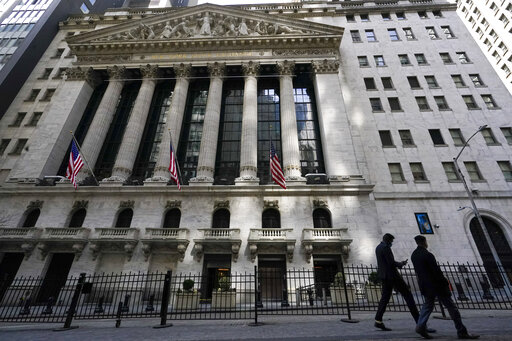 FILE - In this March 23, 2021 file photo, pedestrians walk past the New York Stock Exchange in New York's Financial District.  Stocks are starting August on a strong note after the S&P 500 closed out its sixth straight month of gains.  (AP Photo/Mary Altaffer, File)