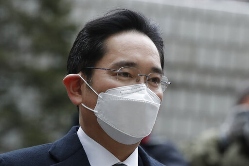 Samsung Electronics Vice Chairman Lee Jae-yong arrives at the Seoul High Court in Seoul, South Korea, Monday, Jan. 18, 2021. South Korean court sentences Lee to 2 and a half years in prison over corruption case. (AP Photo/Lee Jin-man)