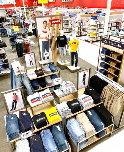 This photo provided by Target shows Levi Strauss & Co. home collection on display at Target.  The Jeans maker is deepening its partnership with Target Corp. by launching its first-ever home collection at the discount chain. Levi's  limited time only 100-item collection of denim-inspired tableware, quilts, pillows and other items will hit Target stores on Feb. 28, 2021. (Target via AP)