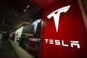 FILE - In this Feb. 9, 2019, file photo, a sign bearing the company logo stands outside a Tesla store in Cherry Creek Mall in Denver.  Record electric vehicle sales last summer amid a shortage of computer chips and other materials propelled Tesla Inc. to the biggest quarterly net earnings in its history. The company said Wednesday, Oct. 20, 2021 that it made $1.62 billion in the third quarter, beating the old record of $1.14 billion set in the second quarter of this year. The profit was over five times larger than the $300 million Tesla made in the same quarter a year ago. (AP Photo/David Zalubowski, File)