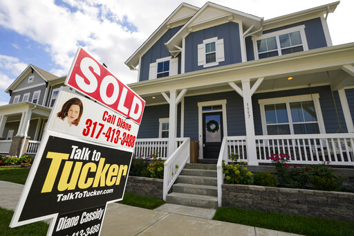 "FILE - A ""sold"" sign is posted on a home in Westfield, Ind., Friday, Sept. 25, 2020.  U.S. long-term mortgage rates slipped this week while remaining at record-low levels. Mortgage buyer Freddie Mac reports, Thursday, Jan. 21, 2021 that the average rate on the benchmark 30-year fixed-rate home loan eased to 2.77% from 2.79% last week.   (AP Photo/Michael Conroy, File)"