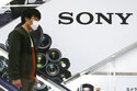 """FILE - In this April 28, 2021, file photo, a man passes by the Sony logo at an electronics retail chain store in Tokyo. Sony's April-June profit rose 9% to 211.8 billion yen ($1.9 billion) as the Japanese electronics and video game maker continued to benefit from a sales perk from the hit """"Demon Slayer"""" animation film. (AP Photo/Koji Sasahara, File)"""