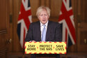 Britain's Prime Minister Boris Johnson during a media briefing on coronavirus (COVID-19) in Downing Street, London, Wednesday February 10, 2021. (Steve Reigate/Pool via AP)
