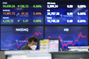 A currency trader watches monitors at the foreign exchange dealing room of the KEB Hana Bank headquarters in Seoul, South Korea, Tuesday, June 8, 2021. Stocks edged lower in Asia on Tuesday after a mixed finish on Wall Street, as investors weighed the risks of inflation against signs the recovery from the pandemic is gaining momentum. (AP Photo/Ahn Young-joon)