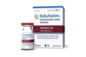 FILE - This image provided by Biogen on Monday, June 7, 2021 shows a vial and packaging for the drug Aduhelm. The first new Alzheimer's treatment in more than 20 years was hailed as a breakthrough when regulators approved it in June 2021, but its rollout has been slowed by questions about its price and how well it works. (Biogen via AP, File)