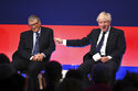 Britain's Prime Minister Boris Johnson, right, appears on stage in conversation with American Businessman Bill Gates during the Global Investment Summit at the Science Museum, London, Tuesday, Oct, 19, 2021. (Leon Neal/Pool Photo via AP)