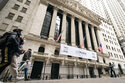 FILE - In this Jan. 27, 2021 file photo, pedestrians pass the New York Stock Exchange, in New York. Stocks were off to a mixed start on Wall Street Thursday, Sept. 16,  as gains for retailers are offset by drops in technology and materials companies.  (AP Photo/John Minchillo, File)