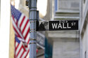 Flags adorn the facade of the New York Stock Exchange, Wednesday, June 16, 2021. Stocks are opening mostly lower on Wall Street Tuesday, June 22 as traders wait for more clues on the Federal Reserve's thinking on inflation.  (AP Photo/Richard Drew)