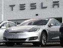 FILE - This July 8, 2018 photo shows Tesla 2018 Model 3 sedans sit on display outside a Tesla showroom in Littleton, Colo. Tesla wants to keep secret its response to the U.S. government's request for information in an investigation of its Autopilot partially automated driving system. The electric vehicle maker sent a partial response by a Friday deadline to the National Highway Traffic Safety Administration, which is investigating how the system detects and responds to emergency vehicles parked on highways. In a document posted on its website Monday, Oct. 25, 2021 the agency says it is reviewing the response and that Tesla has asked that its whole submission be treated as confidential business information. (AP Photo/David Zalubowsi, File)