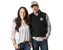 FILE - In this March 29, 2016 file photo, Joanna Gaines, left, and Chip Gaines pose for a portrait in New York. The couple made a name for themselves thanks to their knack for renovating homes. Now they're making the transition to TV executives with the July 15 launch of the first step toward their Magnolia Network, featuring dozens of hours of new unscripted content and archive shows.  (Photo by Brian Ach/Invision/AP, File)