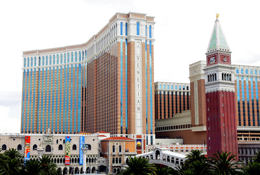 FILE - This Aug. 2, 2005 file photo shows the Venetian Hotel and Casino on the Las Vegas Strip. Las Vegas Sands is selling the real estate and operations of its Venetian casino resort and Sands Expo and Convention Center to VICI Properties and Apollo Global Management in a deal worth $6.25 billion. (AP Photo/Joe Cavaretta, File)