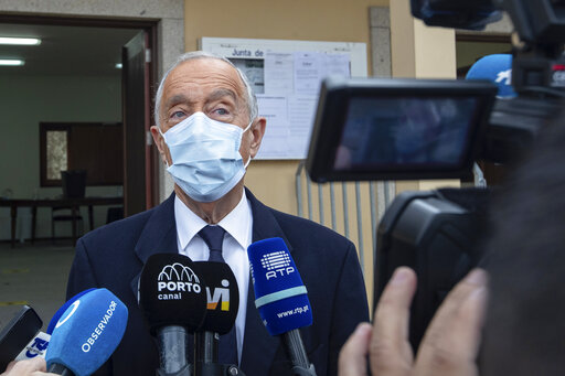 Portuguese President, and candidate for reelection, Marcelo Rebelo de Sousa speaks to journalists after voting at a polling station in Celorico de Basto, northern Portugal, Sunday, Jan. 24, 2021. Portugal holds a presidential election Sunday, choosing a head of state to serve a five-year term. (AP Photo/Luis Vieira)