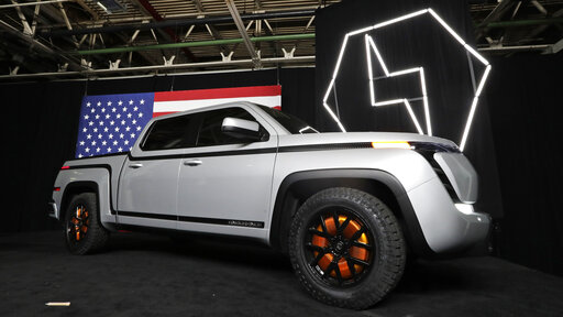 FILE - In this June 25, 2020 file photo, the electric Endurance pick-up truck at Lordstown Motors Corporation is shown, in Lordstown, Ohio. Lordstown Motors CEO Steve Burns and Chief Financial Officer Julio Rodriguez have resigned from the startup commercial electric vehicle maker. The announcement comes less than a week after Lordstown cautioned that it may not be in business a year from now as it tries to secure funding to start full production of the electric pickup truck.  (AP Photo/Tony Dejak, File)