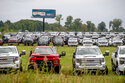 The Chevrolet Silverados and GMC Sierra pickups built at Flint Assembly are packed on Sept. 21, 2021. For the first time in eight months, the global shortage of computer chips won't force General Motors to close any North American factories. The company says Friday, Oct. 22,  that as of Nov. 1, all plants that had been closed on and off since February due to the shortage will be making vehicles. The shortage has forced automakers to sporadically shut down plants since late last year. (Jake May/The Flint Journal via AP)