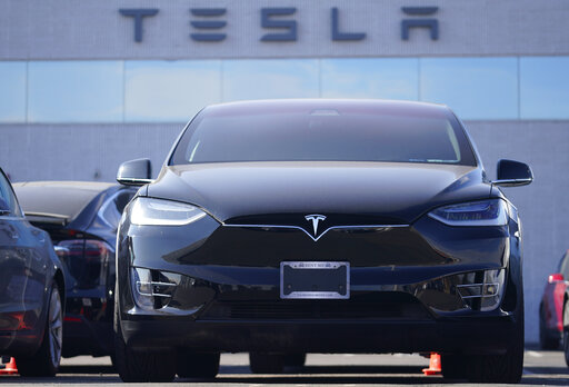 An unsold 2021 Model X sports-utility vehicle sits at a Tesla dealership Sunday, Jan. 24, 2021, in Littleton, Colo. Tesla reports earnings on Wednesday, Jan. 21.  (AP Photo/David Zalubowski)