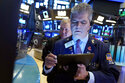 Trader John Panin, foreground, works on the floor of the New York Stock Exchange, Friday, July 23, 2021. Stocks rose in early trading on Wall Street Friday and put the major indexes on track for a strong finish in a week that opened with a stumble. (AP Photo/Richard Drew)