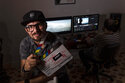 Carlos Gomez, 35, owner of the audiovisual production company Wajiros Films, poses for a photo at his company's editing room in Havana, Cuba, Thursday, Sept. 2, 2021. Most sorts of private businesses have been banned for more than 50 years, but now a new legal system takes effect on Sept. 20 that could greatly expand the scope of private businesses like Gomez´s, and crucially give them greater legal certainty in efforts to help an economy in crisis. (AP Photo/Ramon Espinosa)