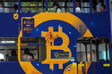 FILE - This May 12, 2021, file photo shows an advertisement for the cryptocurrency Bitcoin displayed on a tram in Hong Kong. Cryptocurrencies have surged to nearly $2.5 trillion in total value, rivaling the size of G7 economies like Canada's and Italy's, with more than 200 million users. At that size, it's simply too large for the financial establishment to ignore. Firms that cater to the world's wealthiest families are increasingly putting some of their fortunes into crypto. Hedge funds are trading Bitcoin, which has big-name banks starting to offer them services around it. And in the latest milestone for the industry, an easy-to-trade fund tied to Bitcoin began trading on Tuesday, Oct. 19, 2021. (AP Photo/Kin Cheung, File)