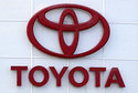 """This Aug. 15, 2019, file photo shows the Toyota logo on a dealership in Manchester, N.H. In a deal announced Wednesday, July 21, 2021, Japan's top automaker Toyota is adding makers specializing in tiny """"kei"""" cars, Daihatsu and Suzuki, to a partnership in commercial vehicles set up with Hino and Isuzu earlier this year. (AP Photo/Charles Krupa, File)"""