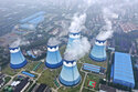 FILE - In this Sept. 27, 2021 file photo, steam billows out of the cooling towers at a coal-fired power station in Nanjing in east China's Jiangsu province. The world's facing an energy crunch. Europe is feeling it worst as natural gas prices skyrocket to five times normal, forcing some factories to hold back production. Reserves depleted last winter haven't been made up, and chief supplier Russia has held back on supplying extra. Meanwhile, the new Nord Stream 2 gas pipeline won't start operating in time to help if the weather is cold, and there's talk Europe could wind up rationing electricity. China is feeling it too, seeing power outages in some towns.  (Chinatopix via AP, file)