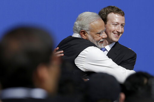 FILE - In this  Sept. 27, 2015, file photo, Facebook CEO Mark Zuckerberg, right, hugs Prime Minister of India Narendra Modi at Facebook in Menlo Park, Calif.. Facebook in India has been selective in curbing hate speech, misinformation and inflammatory posts, particularly anti-Muslim content, according to leaked documents obtained by The Associated Press, even as the internet giant's own employees cast doubt over the motivations and interests. (AP Photo/Jeff Chiu, File)