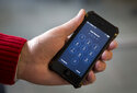 FILE - In this Feb. 17, 2016, file photo an iPhone is seen in Washington. At a time of widespread digital insecurity it turns out that the oldest and simplest computer fix there is — turning a device off then back on again — can thwart hackers from stealing information from smartphones. (AP Photo/Carolyn Kaster, File)