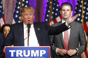 """FILE - In this Tuesday, March 15, 2016, file photo, Republican presidential candidate Donald Trump speaks to supporters at his primary election night event at his Mar-a-Lago Club in Palm Beach, Fla. At right is his son Eric Trump. Hits to President Donald Trump's business empire since the deadly riots at the U.S. Capitol are part of a liberal """"cancel culture,"""" his son Eric told The Associated Press on Tuesday, Jan. 12, 2021, saying his father will leave the presidency with a powerful brand backed by millions of voters who will follow him """"to the ends of the Earth."""" (AP Photo/Gerald Herbert, File)"""
