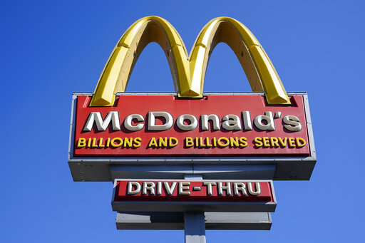 FILE - A McDonald's sign is shown in Philadelphia, Monday, April 26, 2021. McDonald's reported stronger-than-expected sales in the third quarter, boosted by larger orders and higher prices on the menu. Revenue jumped 14% to $6.2 billion in the July-September period, the Chicago burger giant said Wednesday, Oct. 27, 2021. That beat Wall Street's forecast of $6 billion, according to analysts polled by FactSet. (AP Photo/Matt Rourke, File)