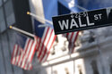 FILE -A sign for Wall Street hangs in front of the New York Stock Exchange, July 8, 2021.  Stocks are off to a mostly lower start on Wall Street Friday, Sept. 17,  as the market heads for a weak ending to an up-and-down week of trading.  (AP Photo/Mark Lennihan, file)